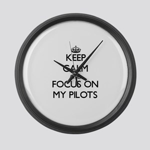 Keep Calm and focus on My Pilots Large Wall Clock