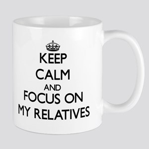 Keep Calm and focus on My Relatives Mugs