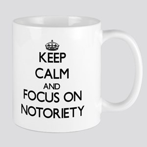 Keep Calm and focus on Notoriety Mugs