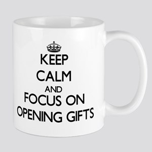 Keep Calm and focus on Opening Gifts Mugs