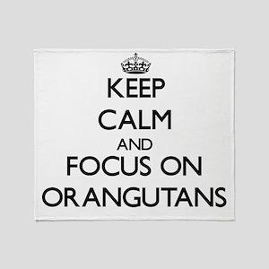 Keep Calm and focus on Orangutans Throw Blanket