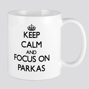 Keep Calm and focus on Parkas Mugs