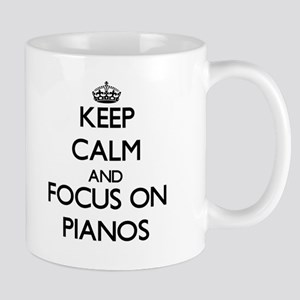 Keep Calm and focus on Pianos Mugs