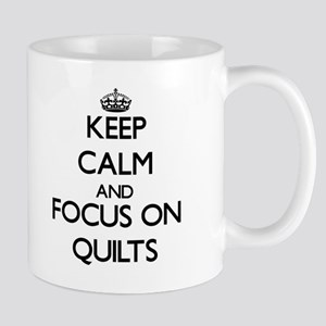 Keep Calm and focus on Quilts Mugs