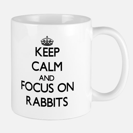 Keep Calm and focus on Rabbits Mugs
