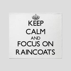 Keep Calm and focus on Raincoats Throw Blanket