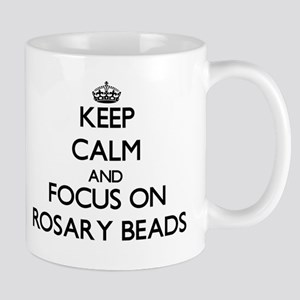 Keep Calm and focus on Rosary Beads Mugs