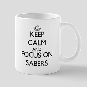 Keep Calm and focus on Sabers Mugs