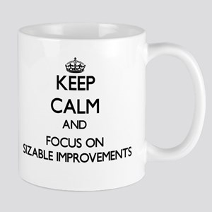 Keep Calm and focus on Sizable Improvements Mugs