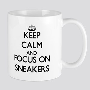 Keep Calm and focus on Sneakers Mugs