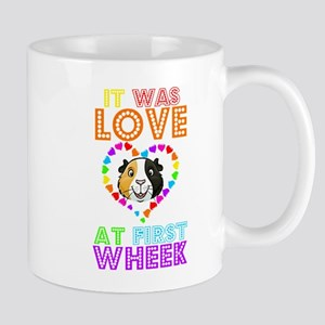 IT WAS LOVE AT FIRST WHEEK Mugs