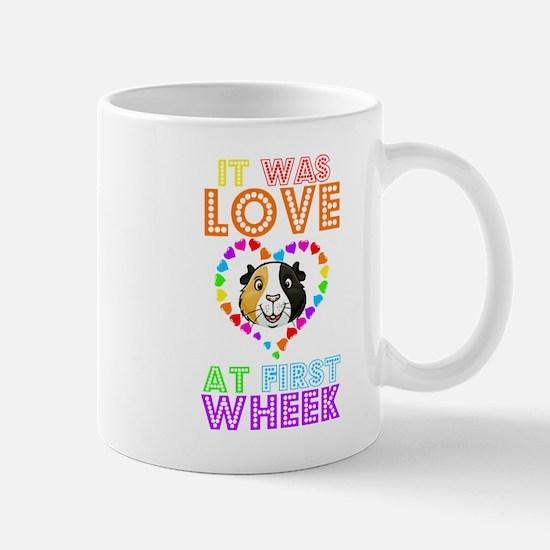 IT WAS LOVE AT FIRST WHEEK Mugs
