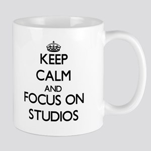 Keep Calm and focus on Studios Mugs