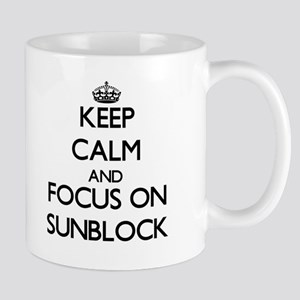 Keep Calm and focus on Sunblock Mugs