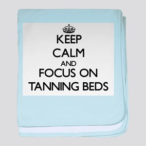 Keep Calm and focus on Tanning Beds baby blanket