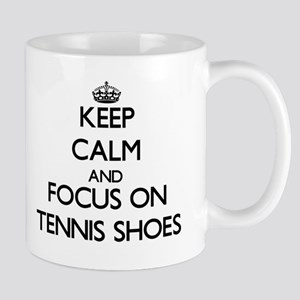 Keep Calm and focus on Tennis Shoes Mugs