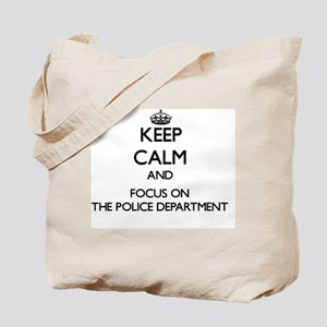 Keep Calm by focusing on The Police Depar Tote Bag