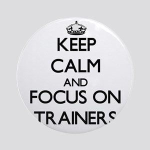 Keep Calm by focusing on Trainers Ornament (Round)