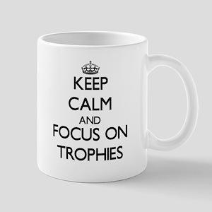 Keep Calm by focusing on Trophies Mugs