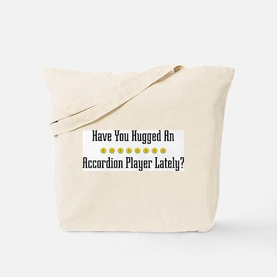 Hugged Accordion Player Tote Bag