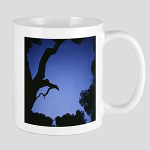 Tree branches in silhouette against blue dusk Mugs