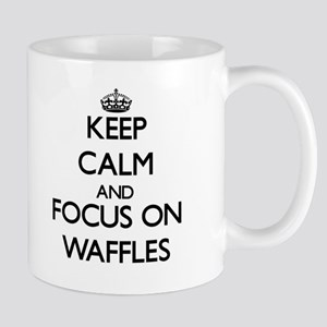 Keep Calm by focusing on Waffles Mugs