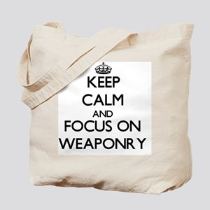 Keep Calm by focusing on Weaponry Tote Bag