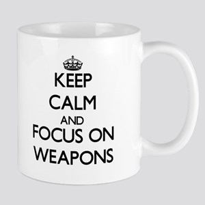 Keep Calm by focusing on Weapons Mugs