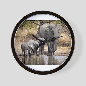 Elephant mom and babies Wall Clock