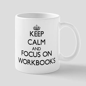 Keep Calm by focusing on Workbooks Mugs