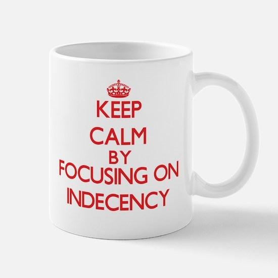 Keep Calm by focusing on Indecency Mugs