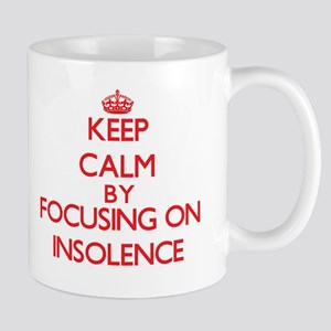 Keep Calm by focusing on Insolence Mugs