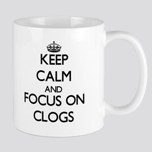 Keep Calm by focusing on Clogs Mugs