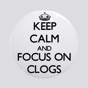 Keep Calm by focusing on Clogs Ornament (Round)