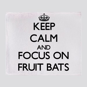 Keep Calm by focusing on Fruit Bats Throw Blanket