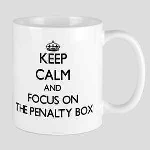 Keep Calm by focusing on The Penalty Box Mugs