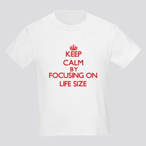 Keep Calm by focusing on Life Size T-Shirt