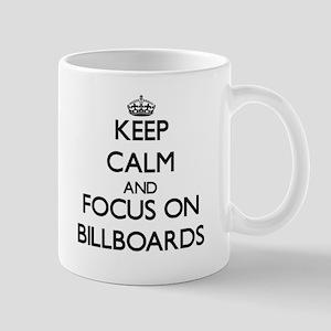 Keep Calm by focusing on Billboards Mugs