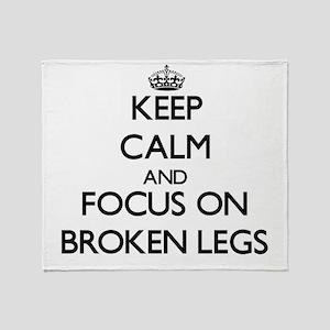 Keep Calm by focusing on Broken Legs Throw Blanket
