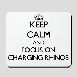 Keep Calm by focusing on Charging Rhinos Mousepad