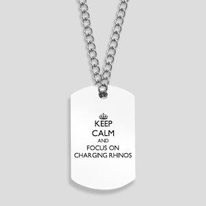 Keep Calm by focusing on Charging Rhinos Dog Tags