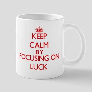 Keep Calm by focusing on Luck Mugs