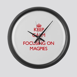 Keep Calm by focusing on Magpies Large Wall Clock