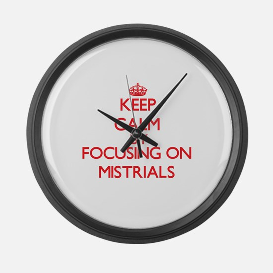 Keep Calm by focusing on Mistrial Large Wall Clock