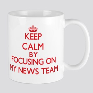 Keep Calm by focusing on My News Team Mugs