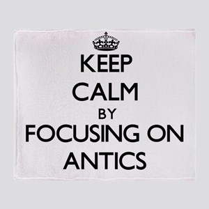 Keep Calm by focusing on Antics Throw Blanket