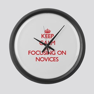 Keep Calm by focusing on Novices Large Wall Clock