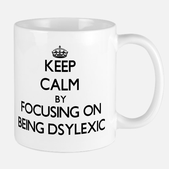 Keep Calm by focusing on Being Dsylexic Mugs