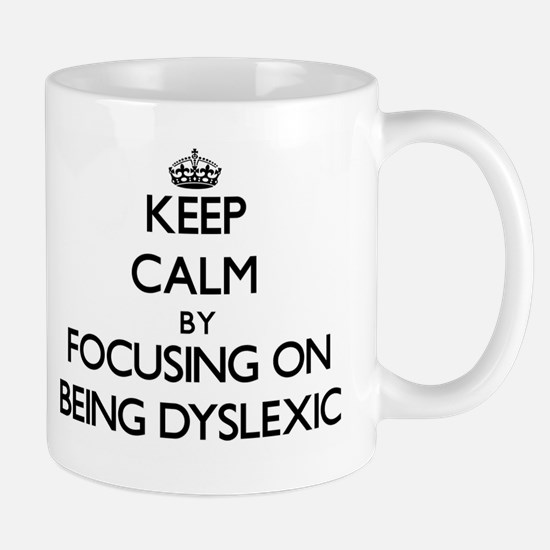 Keep Calm by focusing on Being Dyslexic Mugs