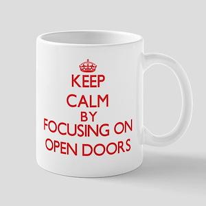 Keep Calm by focusing on Open Doors Mugs